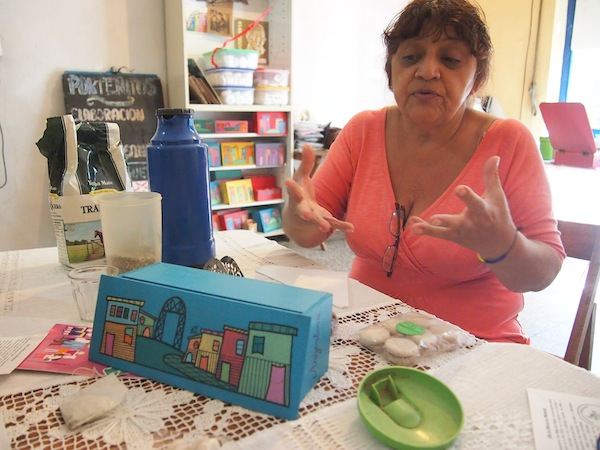 "Cristina Mangravide, of the local cooperative ""Los Pibes del Playón"", has a heart for children and teenagers who she teaches all kinds of crafts and cooking in her local workshop run by volunteers in an attempt to get them away from the streets and crime."