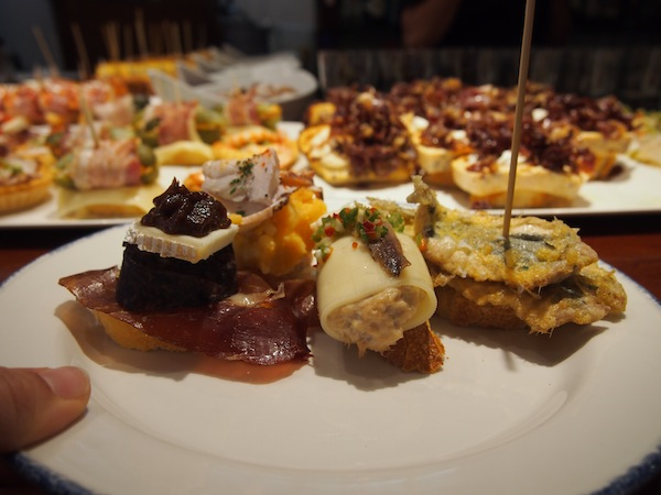 My plate is filling up: At the Pintxos Bar, you just help yourself to whatever tickles your (culinary) fancy.