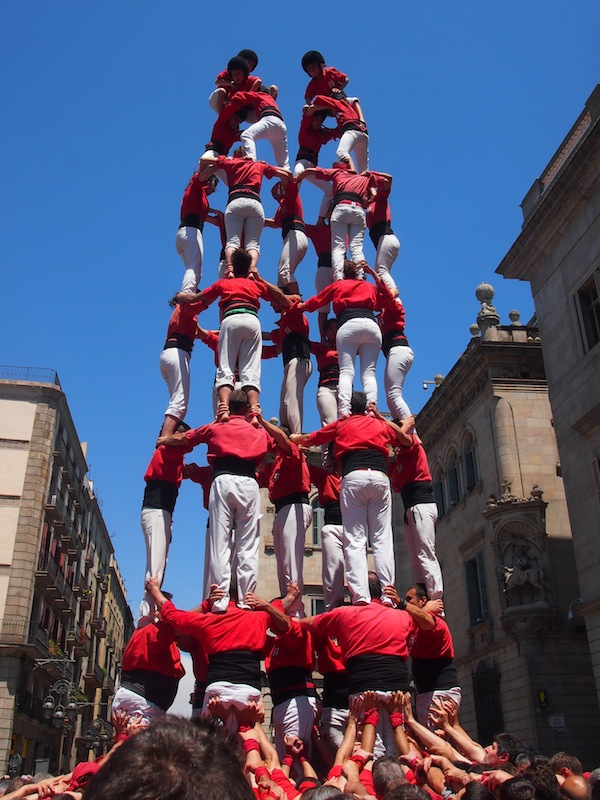 "A little later, Caroline and I happen to be at the right place at the right time: ""Castellers Humanas"", or human towers build up on the City Hall Square of Barcelona."