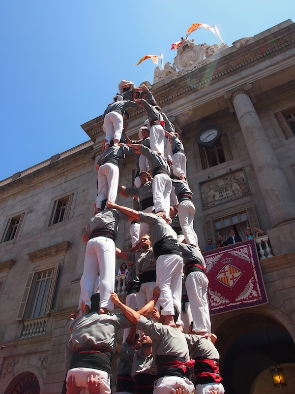 "... climbing up and over 10 metres on these ""human castle towers""."