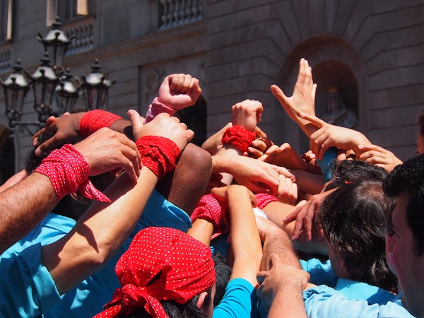 "At the base, many arms are there to support the weight of the entire ""human tower""!"