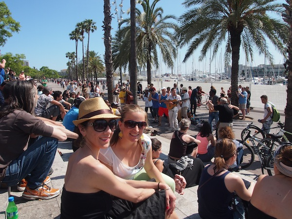 A little later, Caroline and I chill out at the beach promenade of the city's charming port district Barceloneta.