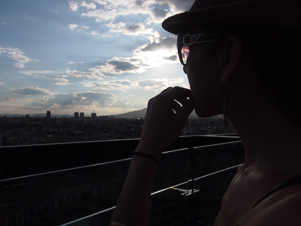 In the evening, Caroline and I enjoy a wonderful panoramic view from a new luxury hotel in Raval …