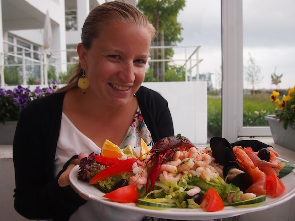 My gourmet seafood salad tastes even better with a glass of wine overlooking the sea …
