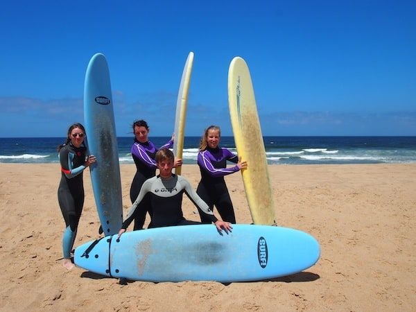 Living to laugh: Posing in our wetsuits on the third day of surfing at the beaches of Portugal.