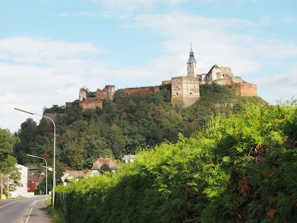 The palace of Güssing can already be seen from afar, towering above its extinct volcanic hill.