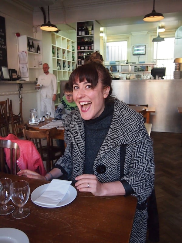What a welcome: This is Nicole, our wonderful Eating London tour guide, with her happy smile and contagious sense of humour!