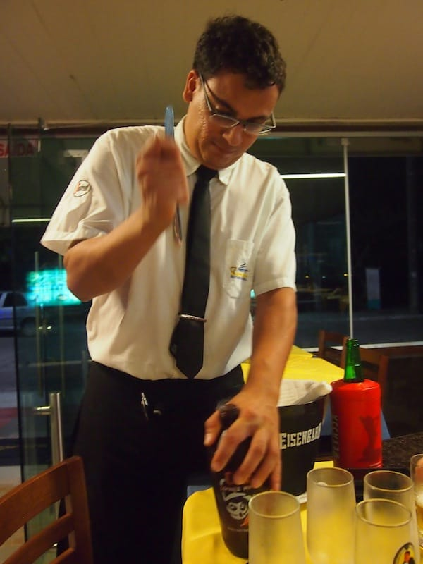 Ready for take-off? Our waiter has made a show of opening my local, artisanal beer bottle at Barracuda Grill restaurant. :D