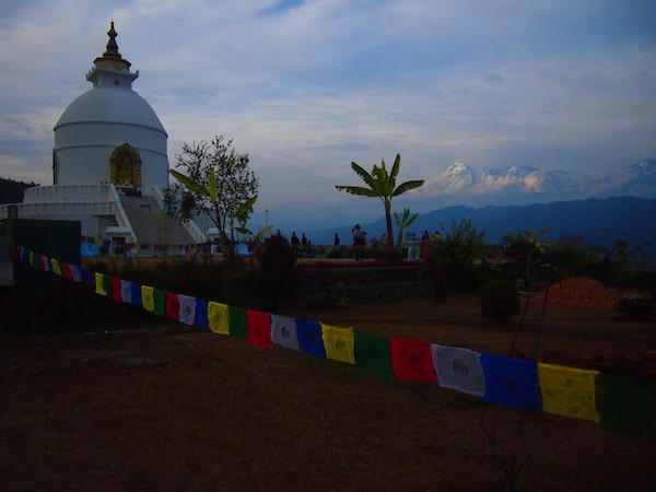 And #OnlyInNepal: View of the Himalayas with a banana tree in the front and a mighty Buddha statue next to it.!