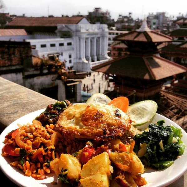 "... followed by later lunch discoveries, such as this ""Newari"" mixed lunch plate including ""chiura"" (beaten rice), spicy veggies & pickles as well as mutton & potatoes. Delicious !!!"
