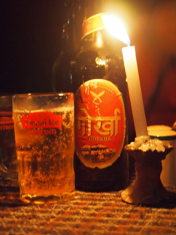 "... and Nepali ""Gorkha"" beer just to mark the occasion: Cheers with Rakesh and his friends by a lakeside bar in Pokhara!"
