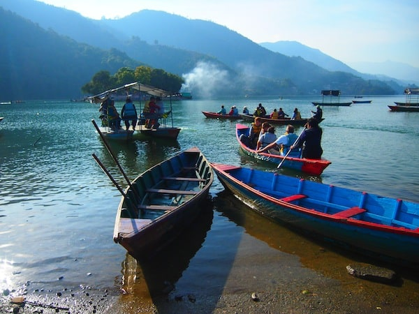 Heading out on Lake Phewa on the shores of the city of Pokhara, Nepal's second-largest ...