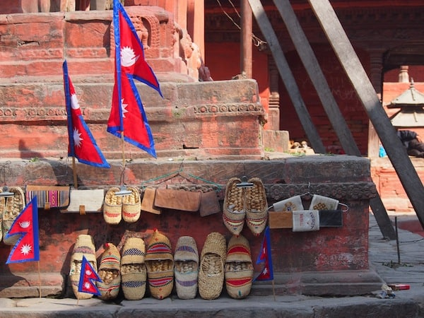 Nearing Durbar Square, some temples bid you to take your shoes off ... or buy some new ones, as exhibited here!