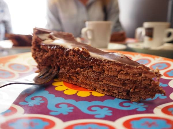 "... a natural occurrence over a most delightful, spongy chocolate cake that the owner is proud enough to call ""Best In The World"" ... I can definitely see where he is coming from!"