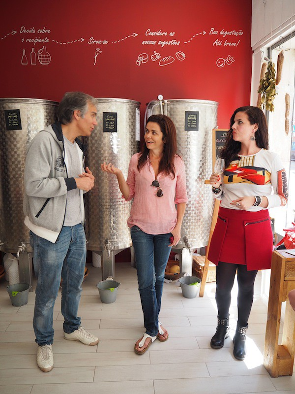 ... as well as chatting to the owner of this food tour stop, Copo do Vinho in Lisbon's peaceful Ourique district.