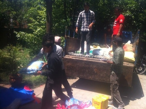 Our volunteer , loading the truck with supplies and ready to send into next affected area