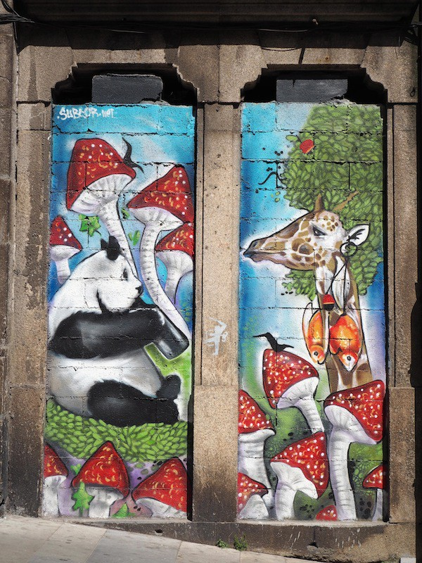 And so is the local Street Art Graffiti: Can you spot the panda drinking wine plus the giraffe wearing sardinha earrings?!