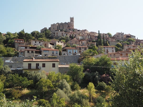 The village of Eus sits high atop a hill, overlooking the surrounding landscape ...