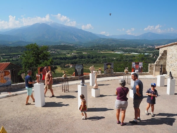 … at the foothills of the Pyrenees, complete with public art on display.