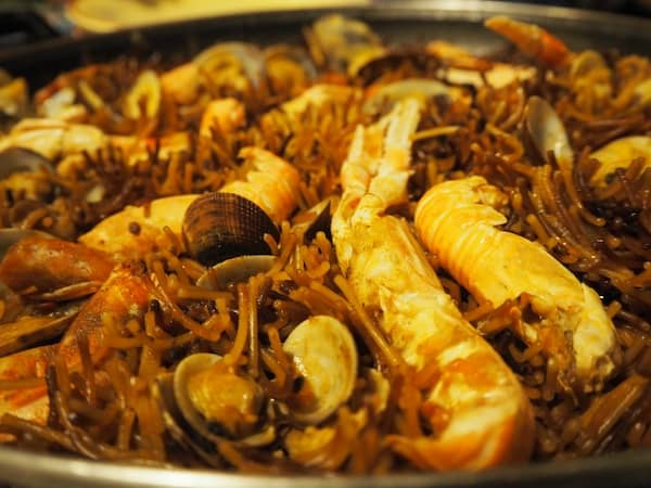 "Or how about a local ""Fideua"", the Catalan version of Paella replacing rice with noodles?"