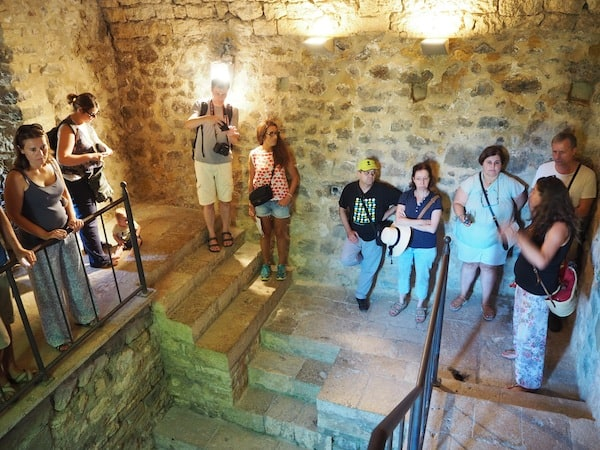 As part of the guided visit, we stop for a cool break in the city's old Jewish baths ...