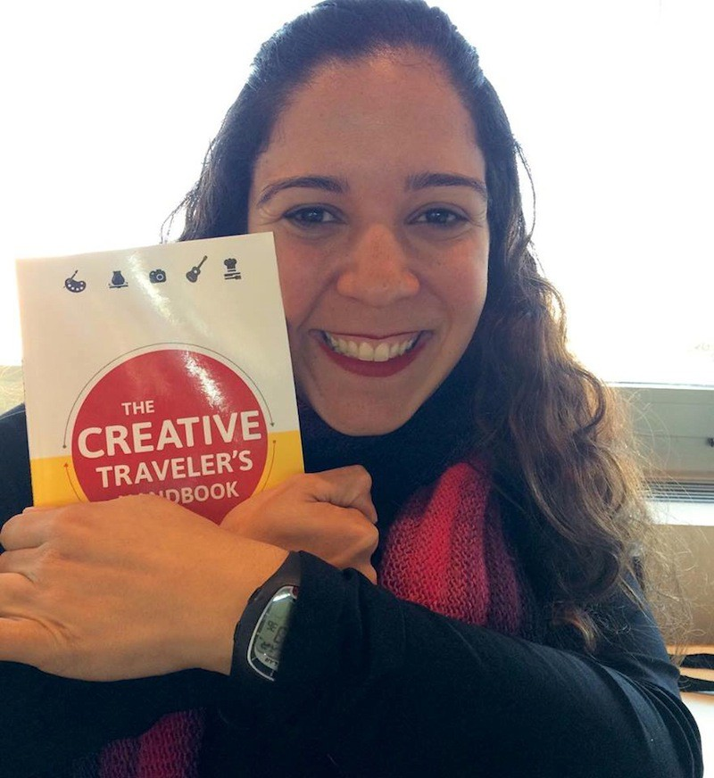 "Marina Simião hugging her personally signed copy of ""The Creative Traveler's Handbook"" in Madrid!"
