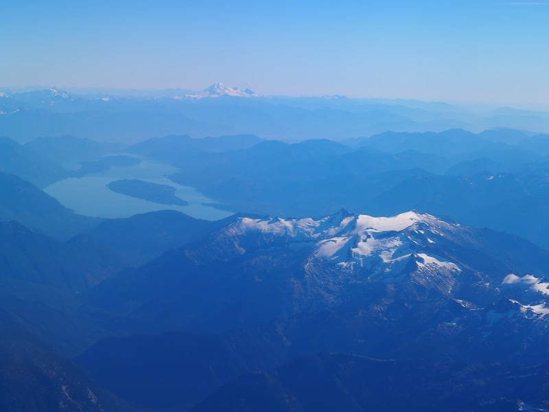 Take a look at these views as we fly over the Rocky Mountains, with glorious snow-capped Mount Baker at the horizon …