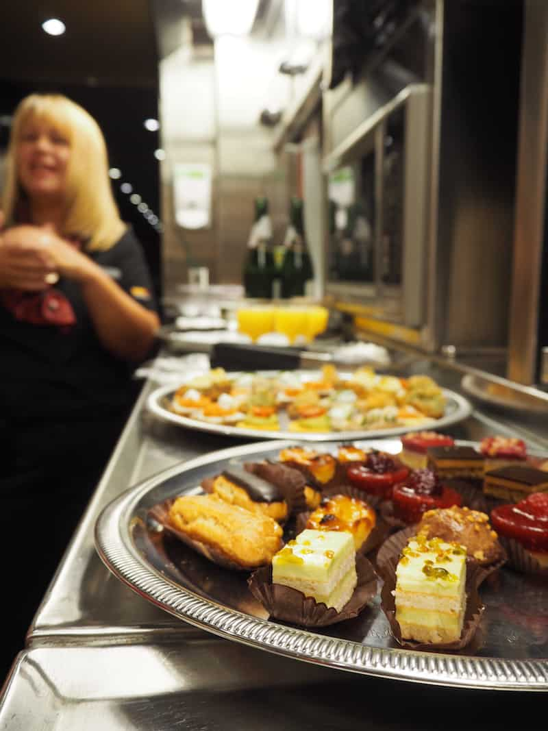 ... and have you ever wondered what you may get spoiled to on a beautiful train such as this one? Canapés, that's right. Sparkling wine. And that warm smile from Jackie I was talking about in the beginning (yep, that's her right there ..!).