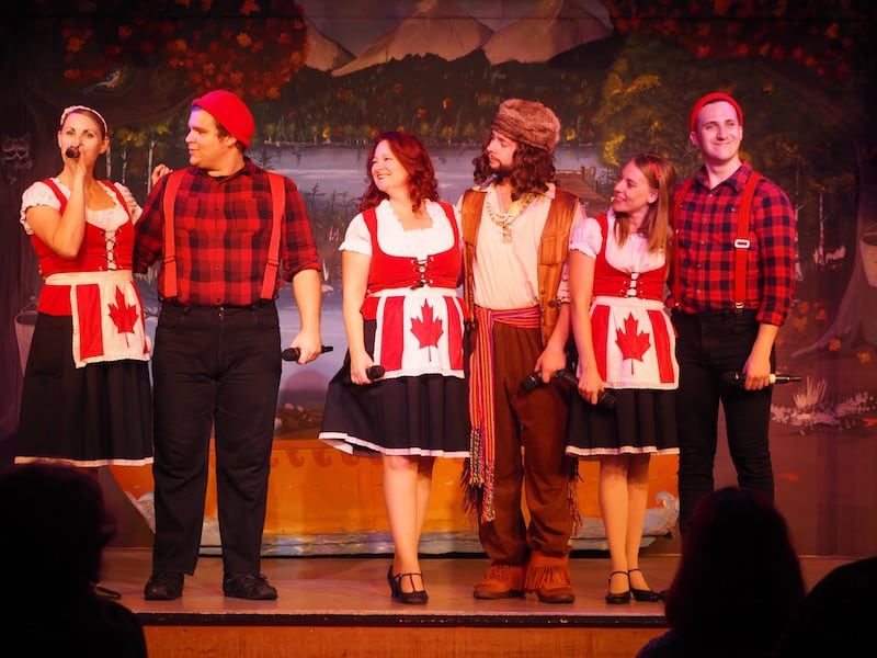 "... where this team wins my heart and respect, doubling as waiters, stand-up comedians, professional singers, dancers & performers on various occasions throughout the three-hour dinner & theatre performance on all things Canada: ""Oh Canada, Eh""!"