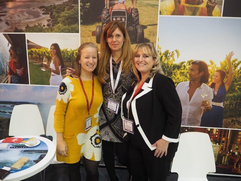"For a start, here are my ""Niagara girls"" at the beautiful Canada booth (where I spend most of my first morning at WTM London ... ""Oh Canada, eh!"") - Just about the same photo exists from this year's travel trade show in Berlin. I love our continued partnership, dear Anna, dear Kelley!"