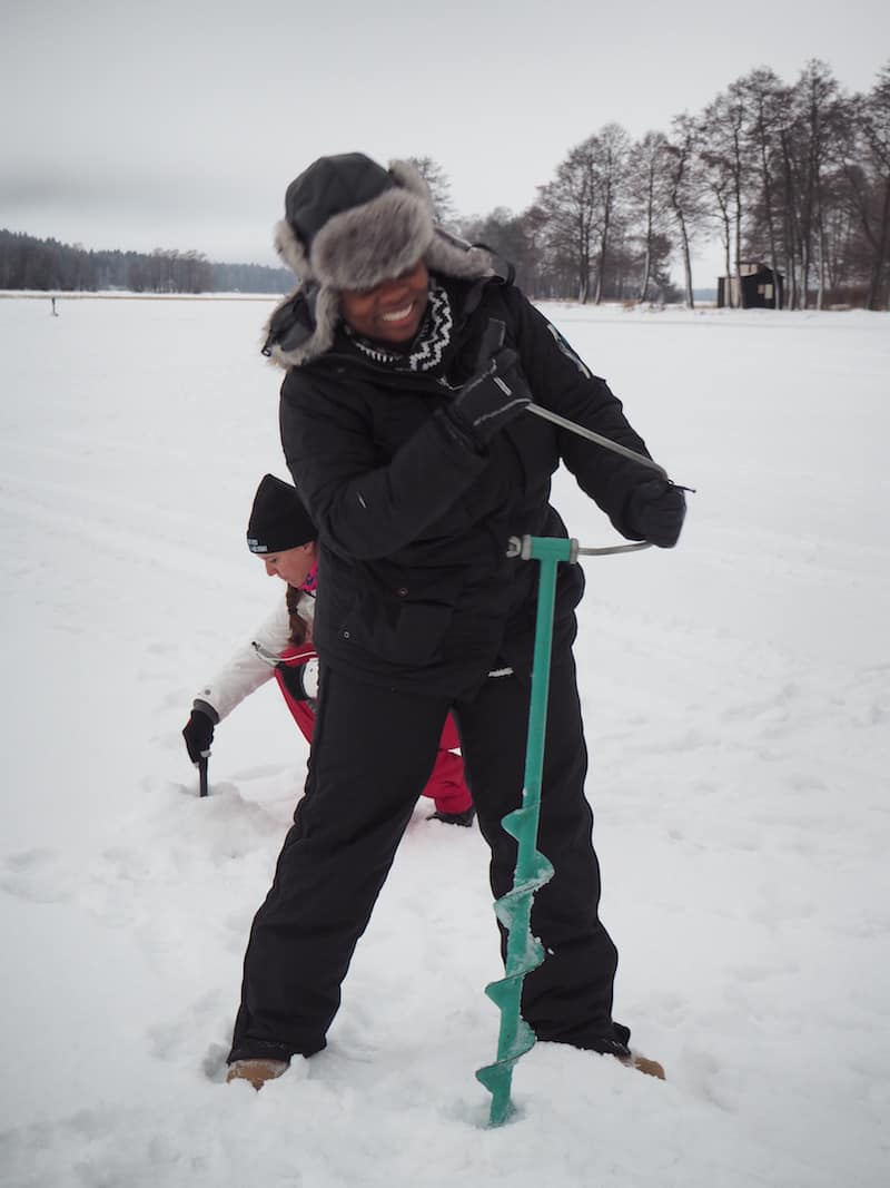 "Of course, there's ""work"" here, too: Learning how to drill holes into a frozen lake for fishing ..."